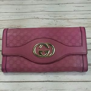 Authentic Gucci GG Monogram Pink Leather Wallet.